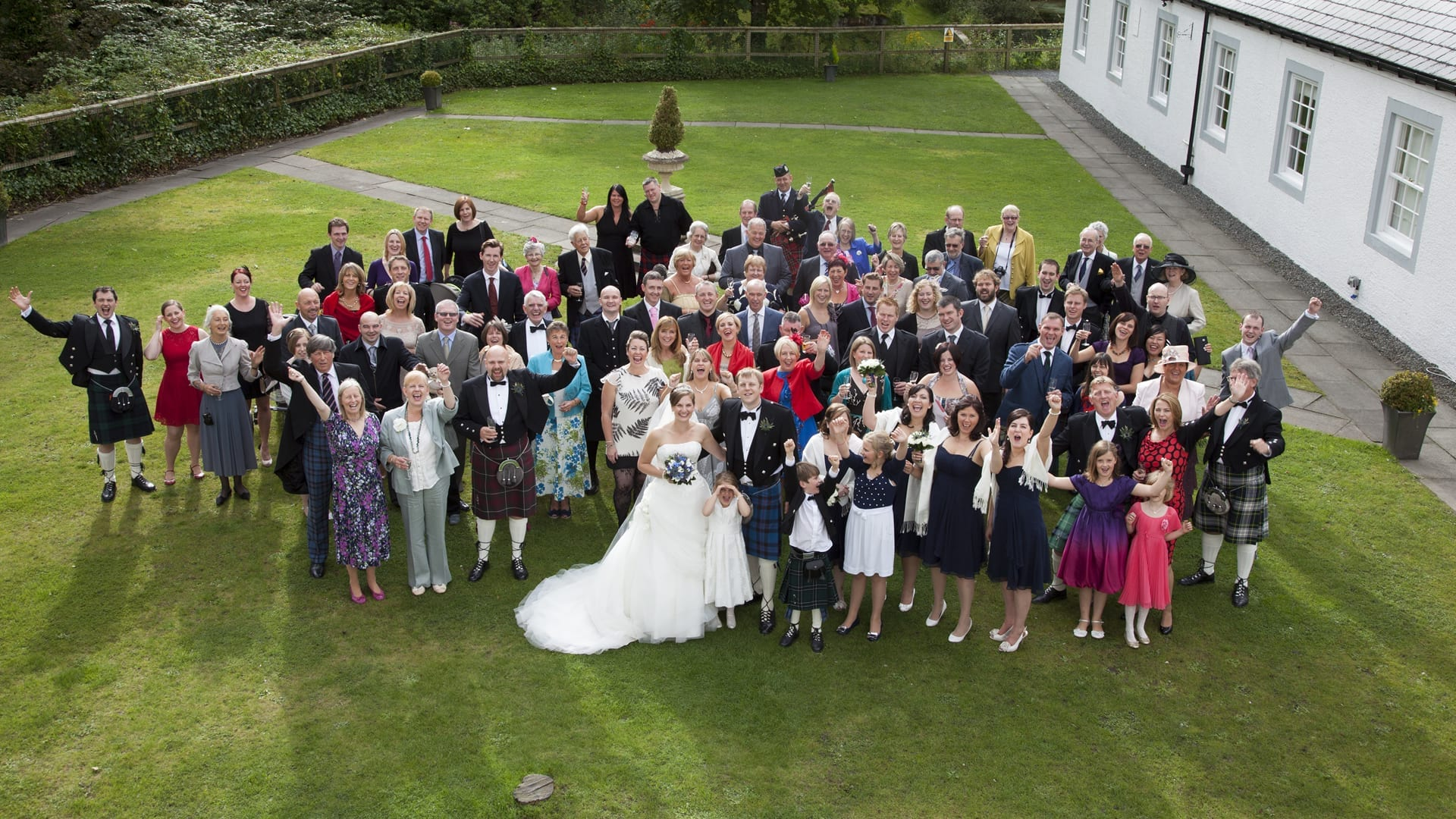 A wedding party in the courtyard at Barony Castle