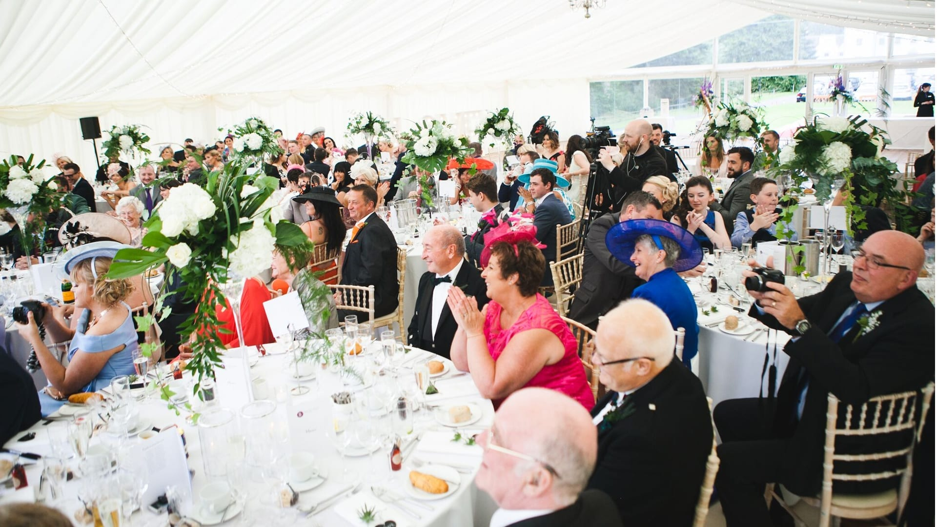 Wedding guests at a marquee reception at Barony Castle